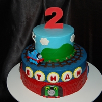 Thomas Cake butter cream with fondant decorations. The Thomas train is a toy.