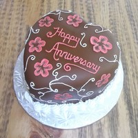 Parent's Anniversary Cake Small heart covered in chocolate MMF. Decorated with RI. First time I have done the brush embroidery since taking the Wilton class nearly...