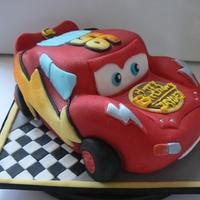 Lightening Mcqueen A cake for my hubby's great grand son's 2nd birthday. It's a vanilla madeira with a chocolate ganache coating then fondant...