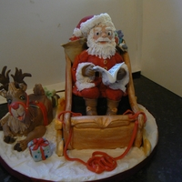 Santa This is my fav cake for Christmas as I made lots as gifts. Sant is all fondant with the sleigh is rich fruit cake covered in marzipan under...