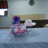 Cowgirl Hat And Boots Don't remember what kind of cake I made. This was back in Feb. made this cake for a young girl in our church whose parents couldn&#039...