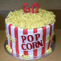 Popcorn Popping!   This cake was carved to look like a popcorn bowl. The popcorn is all buttercream.