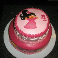 A Pink Dora The Explorer Cake A Dora cake I made for my friend's daughter on her 4th birthday. She loves Dora, princesses and pink so I tried to combine all that...