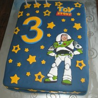 Buzz Lightyear Cake  A cake I made for my friend's son's third birthday. He loves Toy Story. Buzz Lightyear is a royal icing transfer - my first time...