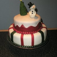 "A Christmas Cake With A Snowman And A Christmas Tree  A cake I made for a christmas ""concert"" my eight-year old decided to hold for family members here at home. He had been practicing..."