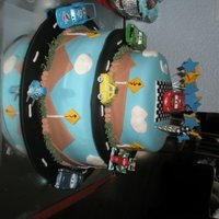 Two-Tiered Cars Cake  A Cars cake I made for my younger son's third birthday. He is obsessed with the movie Cars and he loved the cake :) I got inspired by...