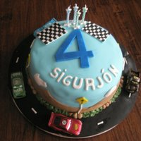 Cars Cake   A Cars cake made for my best friend's son for his fourth birthday. The cars are toys. Thanks for looking :)