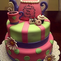 Tea Party Cake chocolate cake with ganache and oreo filling. teapot and teacup are rice krispies treats. handles and spout are gumpaste. everything else...