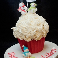 Holiday Cupcake   Red velvet cake with cream cheese icing decorated with fondant snowman daddy, mommy and kiddo LOL.
