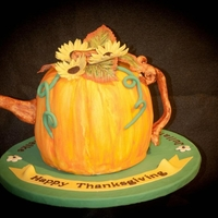 Happy Thanksgiving Teapot Handpainted dark choco fudge cake with chocolate ganache. Flowers, spout and handle are made from gumpaste. TFL!