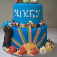 Angry Birds An Angry Birds cake I made for my stepson. Fudge marble cake with chocolate ganache. First time trying ganache underneath fondant and I...
