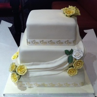 Swags + Roses 3 Tier wedding cake surrounded with swags and roses on points