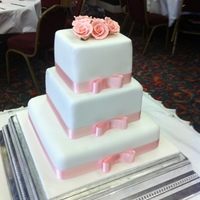 Roses Topper 3 Tier cake with rose cluster topper and bowed ribbon