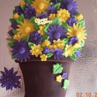 Flower Pot Orange cake with buttercream and fondant accents