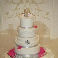 White Wedding With Bling Fashoned after the brides dress, 4 layered dummy cake with real cake cut out. Fondant covered dummies