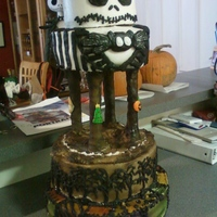 Nightmare Before X-Mas I made this cake for donation to a charity family costume party. The bottom tier is Sally's dress, the second is the forest, and the...
