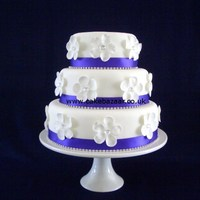 Purple Ribbon With Blossoms Wedding Cake