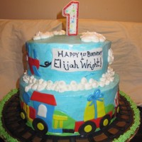 All Boy Cake This was for a 1st bday that was just a boy theme. She wanted balls, planes, trains, etc. Buttercream with MFF accents. TFL!