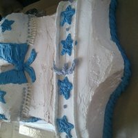 Dallas Cowboys Cheerleader Cake made this one for my husband birthday he loved it!