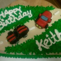 Keith's Birthday Cake made this cake for my co-workers birthday he loves cars. Cars made from fondant!