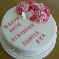 Cluster Of Roses Birthday Cake Lemon drizzle birthday cake with sugar roses and pearls