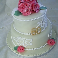 60Th Birthday Cake Ivory fondant covered cake with piped pearls and sugar roses with brush embroidery.