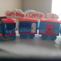 "Choo Choo Soul Train Chocolate cake w/ cookies and cream filling. Designed after choo choo soul ( Disney channel). Gumpaste accents and hand painted ""..."