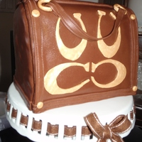 First Purse Cake Chocolate carved cake with Mocha Buttercream filling. Chocolate Fondant coated with gumpaste accents. Thanks to all who inspired me on Cake...