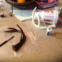 Antlers  I made the antlers out of gum paste. While they are hardening, I put them on a large cup or Crisco can to get a rounded shape. When dry, I...