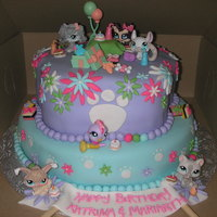 Littlest Pet Shop Cake made for my Goddaughter and her sister on their bday! All fondant except for lps figures/accessories. I put those on the cake so the...