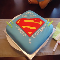 Superman Cake Just a quick little impromptu cake i made for my husband and nephew's double bday. All fondant, and probably the quickest cake i ever...