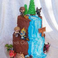"How To Train Your Dragon Waterfall Cake 6/8"". I created the buttercream mountain and waterfall backdrop that the customer added the toy figures to. Ice cream cone trees and..."