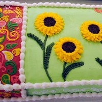 Paisley & Sunflower Cake  Cake was to replicate the napkin used at the bridal shower. It is buttercream w/ fondant paisley accents and cup cakes made to accent...