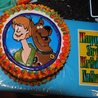 Scooby Doo & Shaggy Run Sugar Cake 2 layer bday cake. Characters made from run sugar. All side accents are fondant