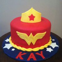 Wonder Woman Cake Chocolate cake with peanut butter buttercream. The cake and board are covered in modeling chocolate and all details are modeling chocolate...