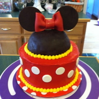Minnie Mouse Cake is red velvet with cream cheese icing. Minnie mouse head is cereal treat covered with modeling chocolate. Bow and all other accents...