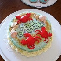 Afternoon At The Beach Birthday cake for a Seafood Boil Party. The crabs are made with marshmallow fondant and the seashells are gumpaste.