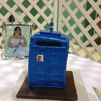 Tardis Groom's Cake Tardis cake for the Groom's cake. Orange Cream-sicle Cake with orange flavored icing.Blue Fondant covered cake, Marbled Brown colored...
