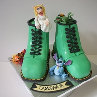 Green Doc Martins, Muppets, Nemo And Stitch Two separate carved cakes, covered with satin ice, filled with vanilla madeira with vanilla buttercream and jam.