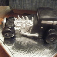 Hot Rod Cake First 3-d car cake took me two days to make. Hard to carve a carrot cake but had fun doing it darn raisins!