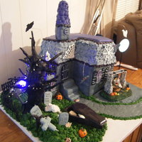 Haunted House I made this cake for a Halloween party. It took me eight days to make. Everyone loved it nobody wanted to cut it.