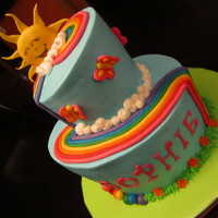 You Are My Sunshine Rainbow topsy turvy cake I made for my daughter. Buttercream cake with Fondant details.