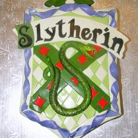 Slytherin Birthday Cake   Vanilla bean cake for a 16 year old girl who loves Harry Potter! All fondant details (snake's fangs are toothpicks).