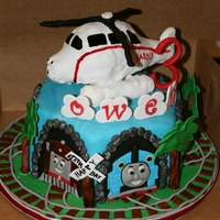 Thomas And Friends Made this for a little boy who loves Thomas the Train and Harold the Helicopter. Harold is made from rice krispie treats. Each side of the...
