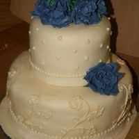 Ivory And Blue Wedding Ivory and blue wedding cake. Handmade gumpaste roses and hand piped details
