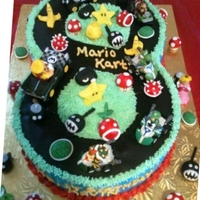 "Mario Kart ""8"" Track Mario Kart Cake all edible except the actual karts; they're the birthday boys' toys."