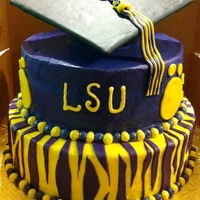 Louisiana State University Graduation Louisiana State University Graduation cake. Butter cream with fondant decorations. All edible BUT the flat part of the graduation cap.