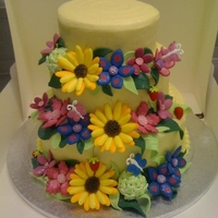Sunflower Wedding Cake vanilla sponge with vanilla frostingrun out flowers to match brides bouquet made from royal icing