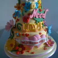 All You Need Is Love bespoke wedding cakechoc, vanilla and lemon spongeall decoration made from sugar paste