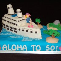 Aloha To 50! RKT cruise ship covered in fondant. Flowers and lettering cut with Cricut. First time modeling a person. Time consuming, but fun to do!
